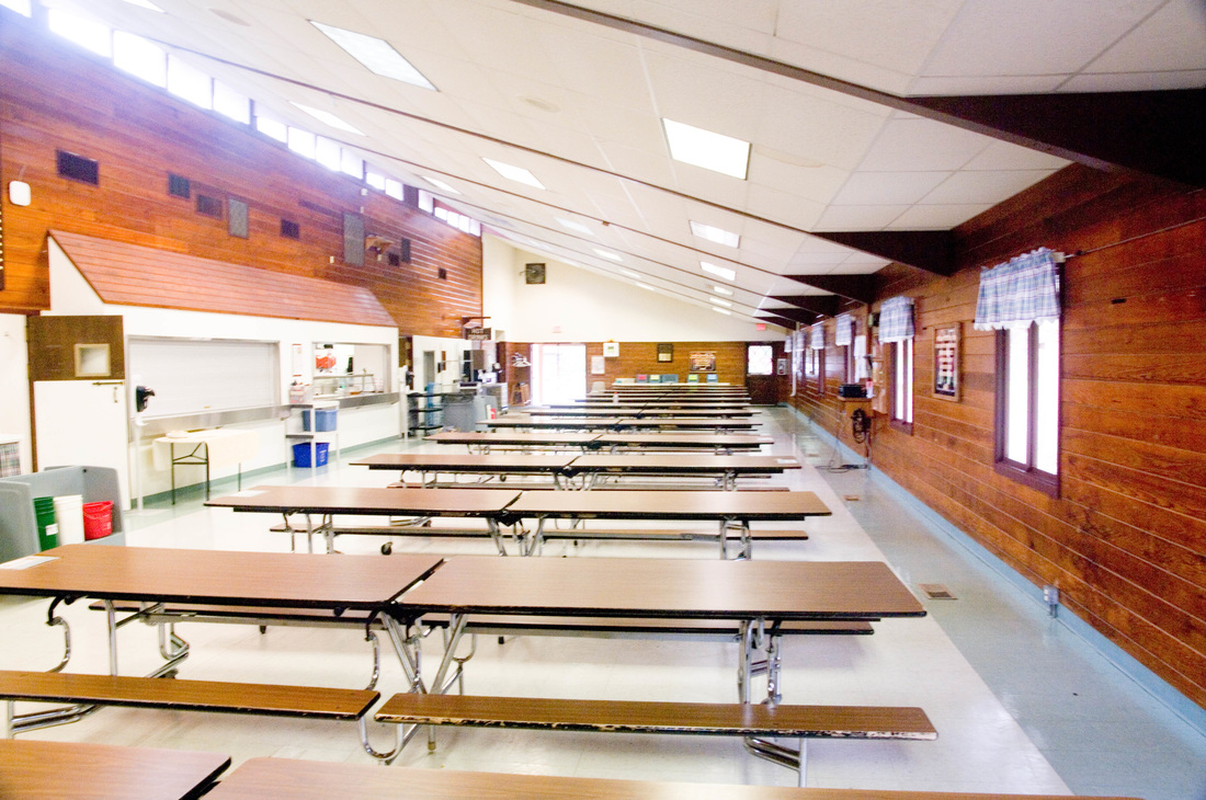 dining hall interior with long cafeteria-style tables