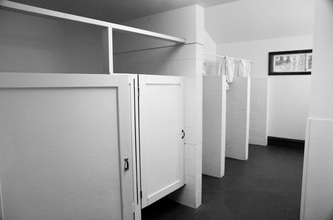 toilet stalls and showers with privacy curtains