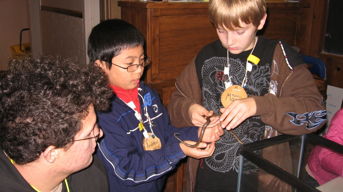 students holding snake