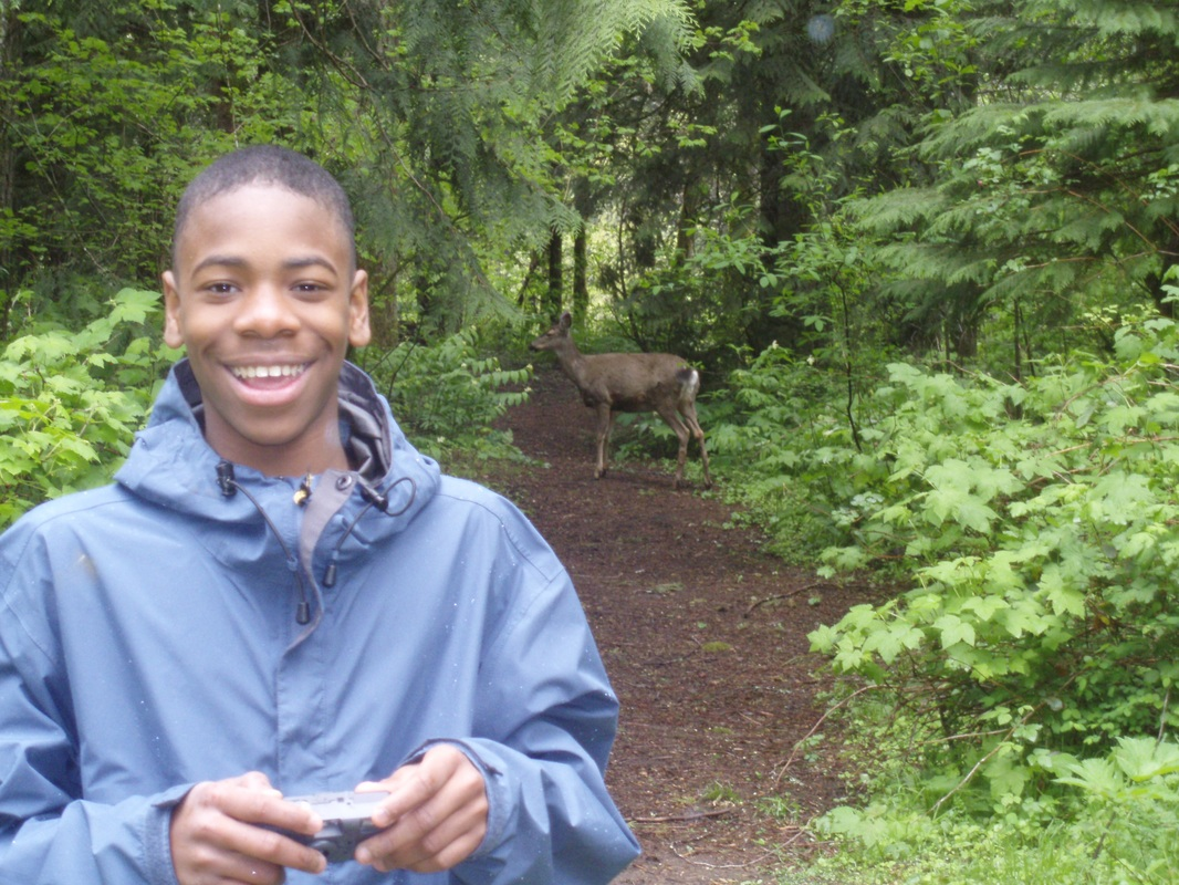 student with deer in background