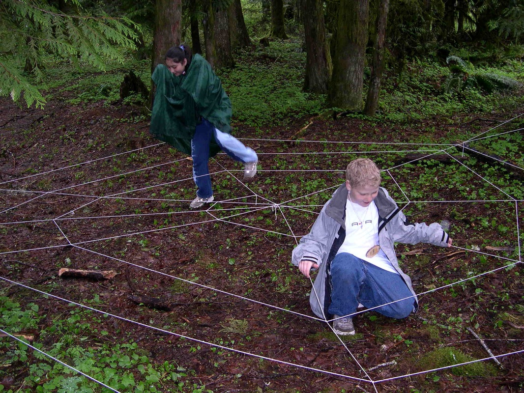 student doing spider web activity
