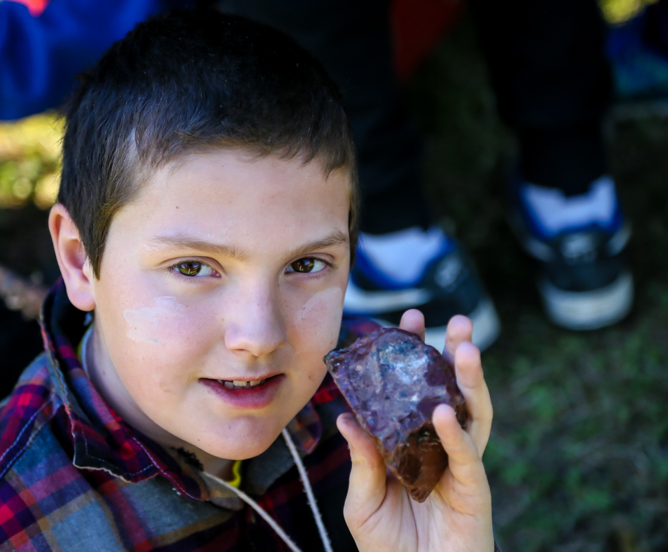 student holding rock